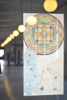 A group of elaborate mandalas bring life to the Old Post Office display cases.