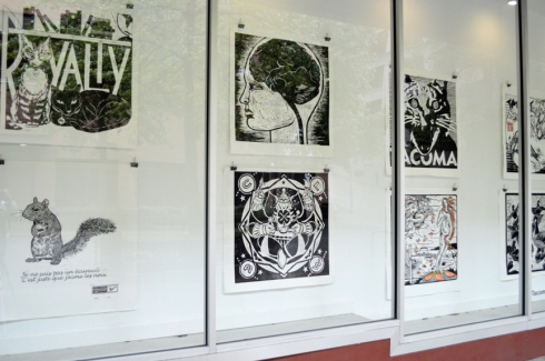 Lino-cut prints from Wayzgoose 2013, curated by Jessica Spring, on display in the Woolworth windows