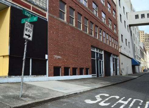 A coat of fresh black paint, and now these alleyway panels are ready for Write@253 to begin their POETRY MURAL!