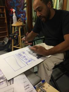 Jeremy Gregory looking over his new design for this years Two Five Trees.  Photo by Two FIve Trees
