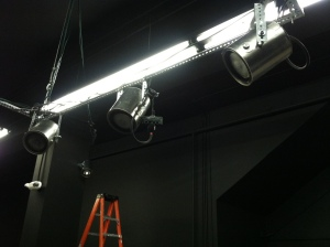Super clever paint can lighting system above the main stage.
