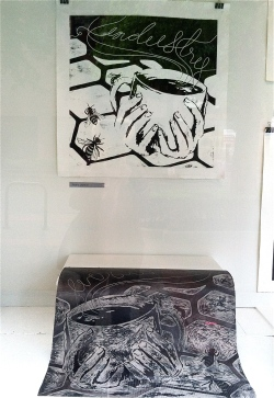 An Audra Laymon print and the inky linoleum slab it was rolled from.