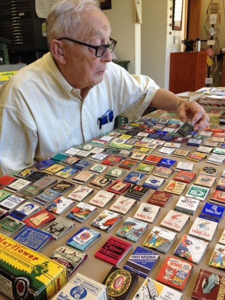 Jack Spring, father of artist Jessica Spring, pores over his amazing matchbook collection.