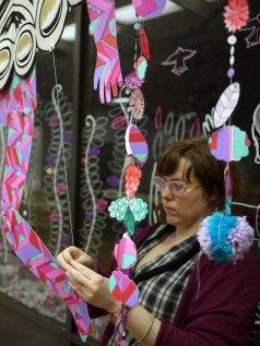 Erika Rier installing Mythic Ephemera at 1120