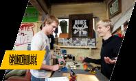 Grit City Grindhouse owner Bobby Boyle shows customer skateboard trucks