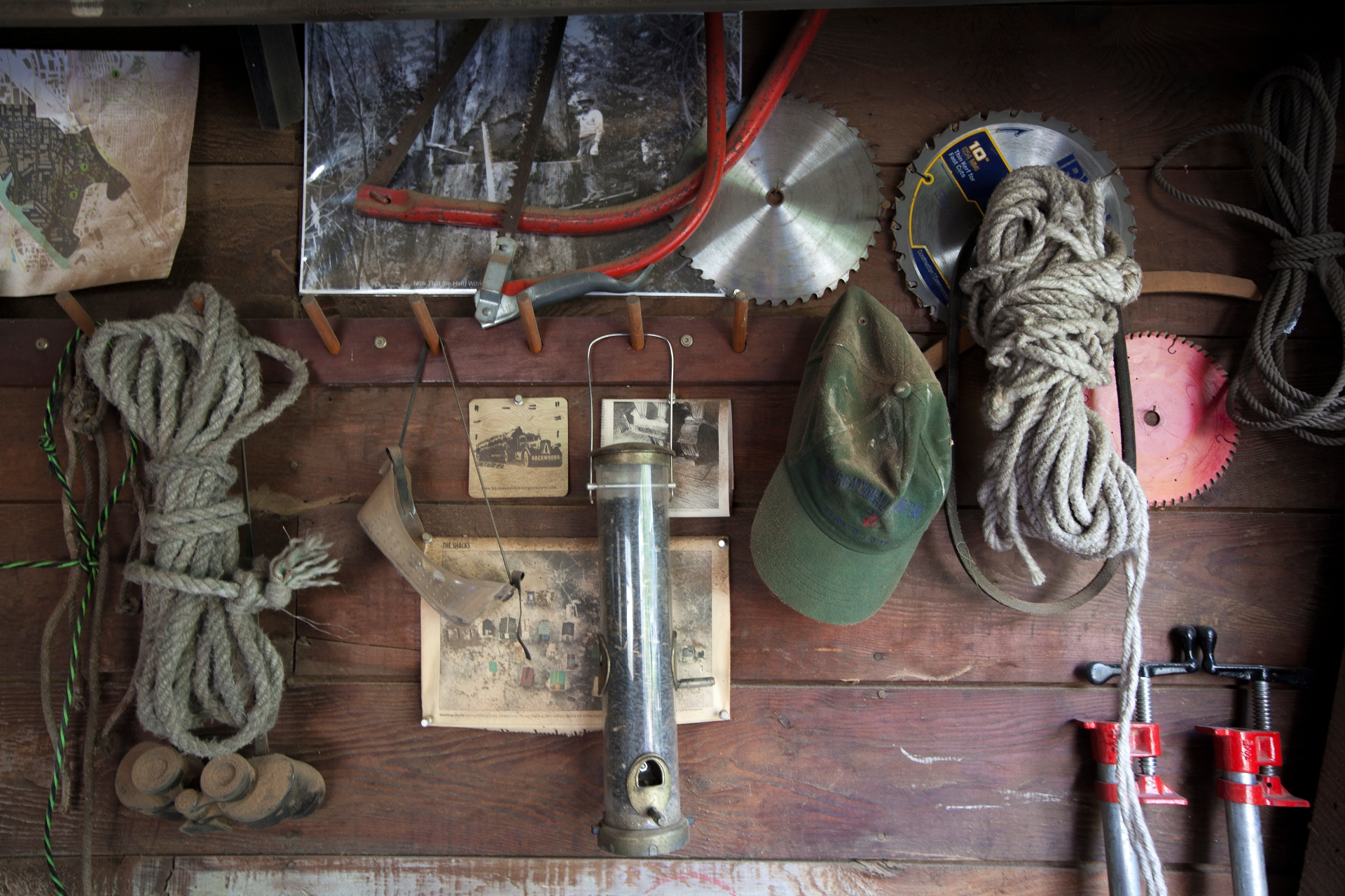 Tools and vintage photos hanging on a wall in birdloft workshop