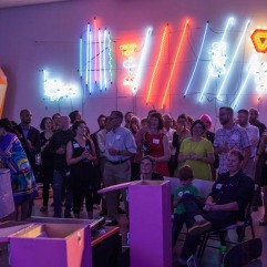 Heather Joy addresses the audience at NEON, Spaceworks' inaugural auction/fundraiser in 2016. The event, hosted at Alma Mater, raised over $54,000 thanks to all who attended and participated. Photo by Scott Haydon.