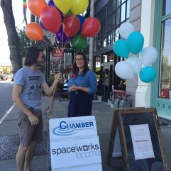 Gabriel Brown delivers colorful balloons to Liz Van Dyke for Stocklist Grand Opening. Liz completed Creative Enterprise Tier I training in Spring 2016 and opened the business in July. Photo courtesy of Spaceworks.