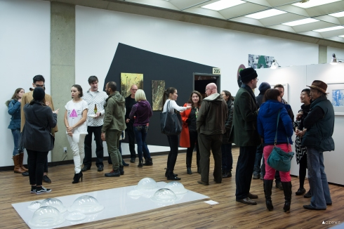 Tacoma artists and art patrons mingle at 1120 Creative house. Third Thursday Artwalk, November 2015.